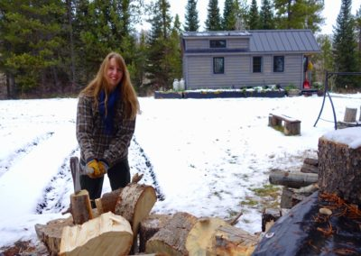 ariel mcglothin splitting wood for her tiny house