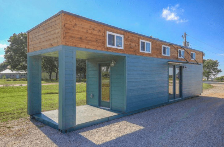 shipping container tiny house with a porch
